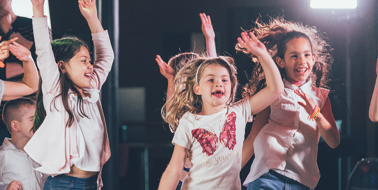 Children dancing the Happy song